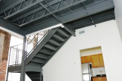 Metal stair case, historic brick architecture, hardwood ceilings