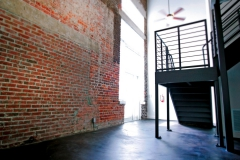 Old brick and new metal staircase at The Lofts San Marco