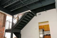 Old brick and new metal staircase at The Lofts San Marco, contemporary kitchen